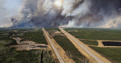 An aerial view of Highway 63 south of Fort McMurray, Alberta. Canada, shows smoke from the wildfires taken from a CH-146 Griffon helicopter May 5, 2016.  MCPL VanPutten/Canadian Armed Forces/Handout via Reuters   ATTENTION EDITORS - THIS IMAGE WAS PROVIDED BY A THIRD PARTY. EDITORIAL USE ONLY