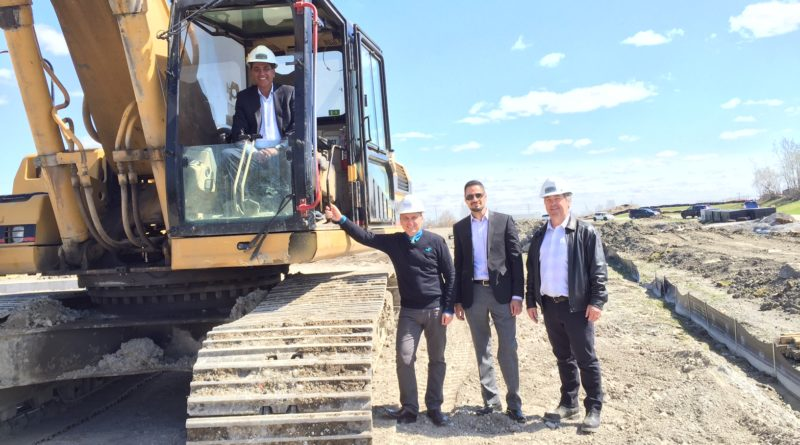 S. Dilawri Automotive Group owner Shiv Dilawri took control of a backhoe to start the construction of Barrhaven Chrysler. To his right are Scott Moffatt, city councilor, Elias El-Achab, group director of operations, and Chris Ford of MB Ford Construction.